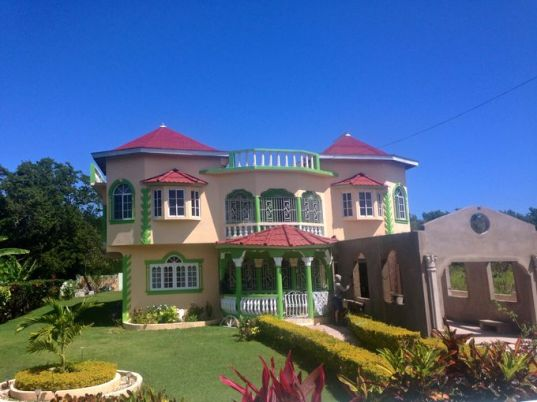 Nowadays, colorful beachside homes dot the Jamaican countryside. (Photography Jenna Intersimone)