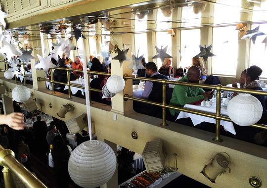 Anywhere from two to 10 people may be seated at a pre-assigned table, depending on the number of people on a ship during a given cruise. (Photo: ~Courtesy of Cornucopia Cruise Line)