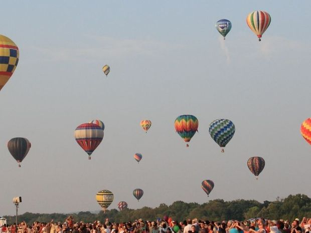 Twice a day, at sunrise and sunset, the balloons will take to the sky with pilots from 21 states and four countries at the 33rd annual festival. (Photo: ~Courtesy of Rebecca Mensch/Mensch & Company Inc.)