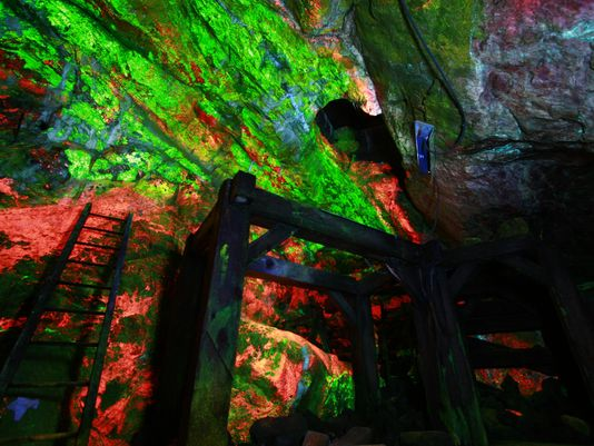 In the Rainbow Tunnel, brightly fluorescent zinc ore is exposed in the mine walls. (Photo: ~Courtesy of Sterling Hill Mining Museum)
