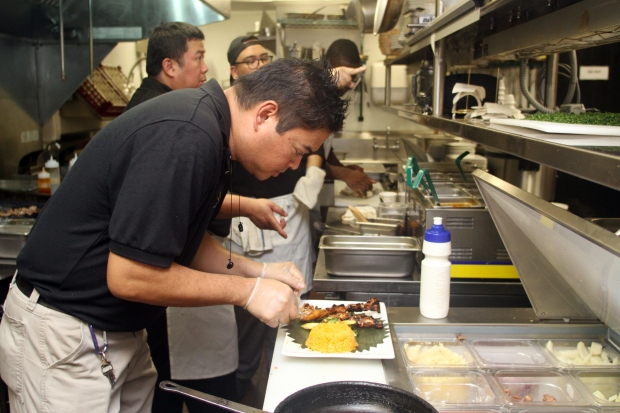 Chef Homer Reyes works in the kitchen at La Parilla de Manila, Wednesday, August 19, 2015, in Colonia, NJ.