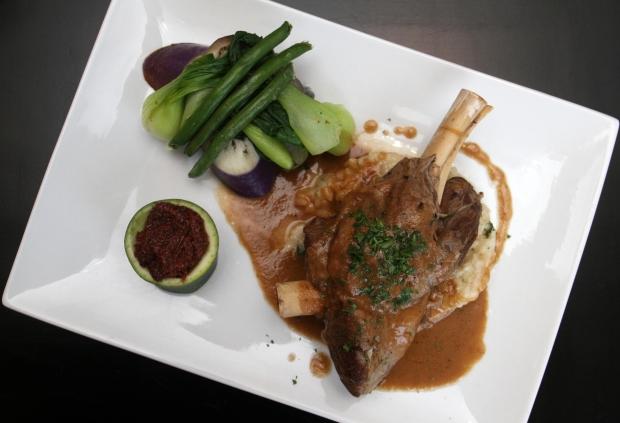 Lamb shank kare kare by chef Homer Reyes at La Parilla de Manila, Wednesday, August 19, 2015, in Colonia, NJ.