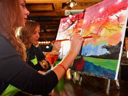 Wine-and-paint studios don't teach people how to paint or expect them to know how – they show them how to recreate one particular painting in small, manageable steps. (Photo: ~Courtesy of Paint Nite)