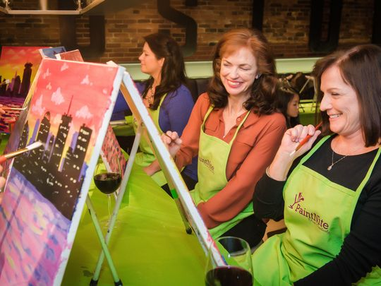 Wine-and-paint studios do not require a certain level of artistic ability, although many feel some apprehension when they walk through the door and see that the painting they will soon be recreating appears complicated. (Photo: ~Courtesy of Paint Nite)