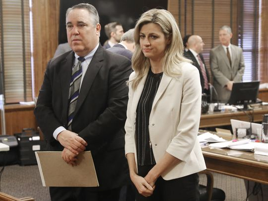 Sportscaster and television host Erin Andrews, right, stands with attorney Scott Carr as the jury enters the room during her civil trial Thursday, Feb. 25, 2016, in Nashville, Tennessee. Andrews filed and won a $75 million lawsuit against the franchise owner and manager of a luxury hotel and a man who admitted to making secret nude recordings of her in 2008. (Photo: ~Courtesy of Alan Poizner, Alan Poizner, AP)