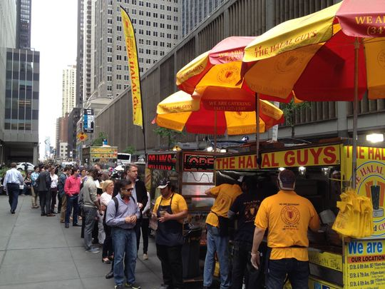 Halal Guy food cart lines can last for hours. (Photo: ~Courtesy of the Halal Guys)