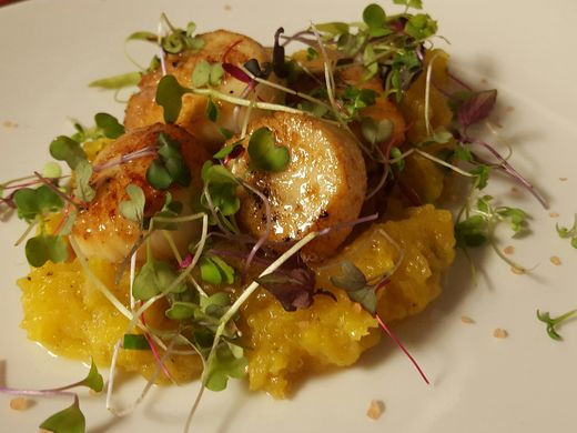 Scallops over roasted butternut squash with crispy leeks and brown butter. ~Courtesy of Tapastre