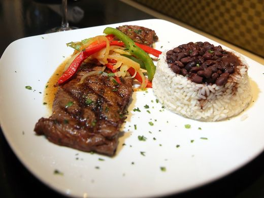 Beef skirt steak with black beans and white rice at La Terrazza Cubana.  Mark R. Sullivan/Staff Photo