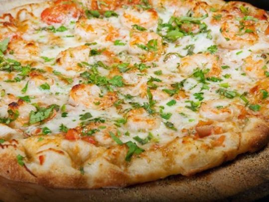 Shrimp scampi pizza is a popular seafood pizza at Carlo's. (Photo: ~Courtesy of Carlo's Gourmet Pizza)