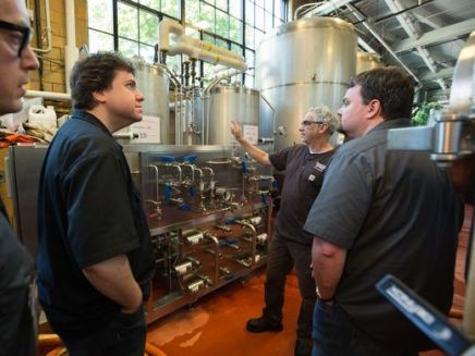 Jeremy Lees and Flounder Brewing co-owners Dan Lees and Billy Jordan during their experienceship at Samuel Adams in Boston.