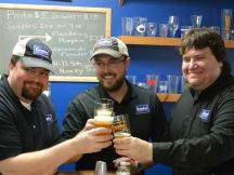 Jeremy Lees and Flounder Brewing co-owners Dan Lees and Billy Jordan. ~Courtesy of Flounder Brewing