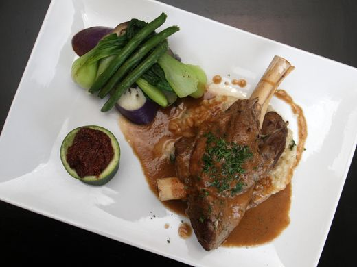 Lamb shank kare kare by chef Homer Reyes at La Parilla de Manila, Wednesday, August 19, 2015, in Colonia, NJ.  Jason Towlen/Staff Photographer