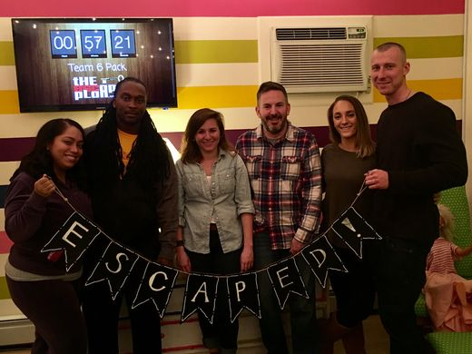 Columnist Jenna Intersimone, third from left, escaped the room within 60 minutes with her team.  ~Courtesy of The Escape Plan