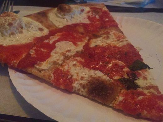 A slice at Grimaldi's Brick Oven Pizza.  Jenna Intersimone/Staff Photo