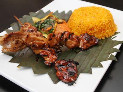 Pork barbeque combo by chef Homer Reyes at La Parilla de Manila, Wednesday, Aug. 19, 2015, in Colonia, NJ. (Photo: Jason Towlen/Staff Photographer)