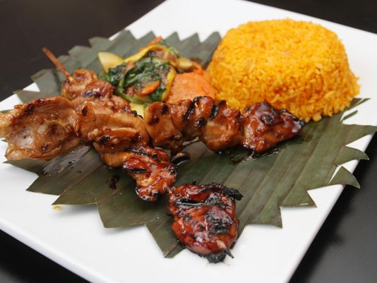 Pork barbeque combo by chef Homer Reyes at La Parilla de Manila, Wednesday, Aug. 19, 2015, in Colonia, NJ. (Photo: Jason Towlen/Staff Photographer)